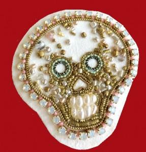 White skull brooch