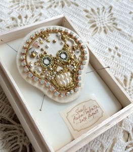 White skull brooch