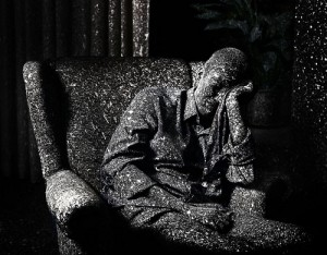 A man in the armchair. Photo series 'And Then It Hit Me'. Dutch photographer Jaap Vliegenthart