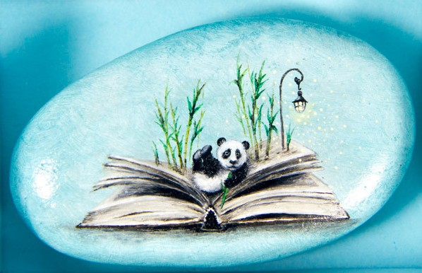Opened book and panda