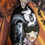 Death behind Harlequin mask
