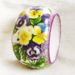 'Pansies'. Handmade bracelet in the decoupage technique. Work by Moscow based artist Maya Valit