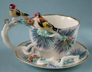 Two birds on a pine branch. Porcelain miniature. Handmade art by Svetlana Oreshkina