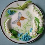 Green lizard and flowers. Porcelain miniature. Handmade art by Svetlana Oreshkina