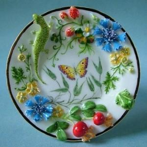 A saurce decorated with beautiful Porcelain miniatur