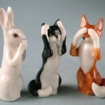 A hare, a cat and a fox. Porcelain by Svetlana Oreshkina