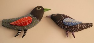 Two hand made painted birds
