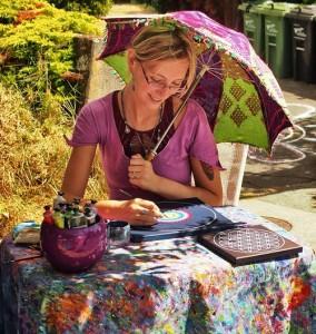 Artist Elspeth McLean painting mandala stones
