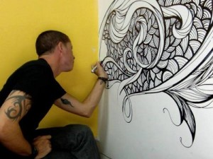 Dominican artist Willy Gomez at work