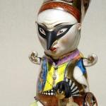 Masked jester. Porcelain art by Irina Zaitceva
