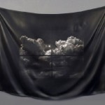 Black color silk cloth with elements of painting. Hyperrealistic wooden sculpture by professor Tom Eckert