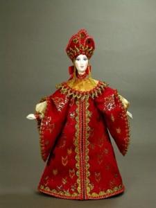 National costume. Russian doll, handmade. Biscuit porcelain, textiles, acrylic paint. Artist SY Krishtan