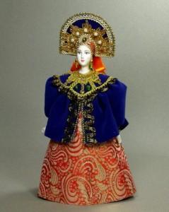 Gorgeous Russian doll in a folk dress. Author IV Bannikova
