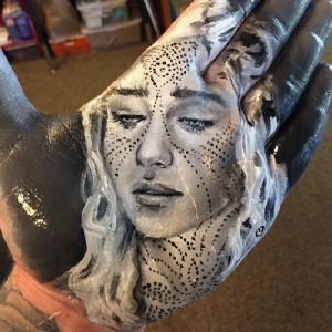 Amazing art by Russell Powell – painting on palm