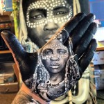 Ethiopian woman. Portrait painted on palm. Art by Russell Powell
