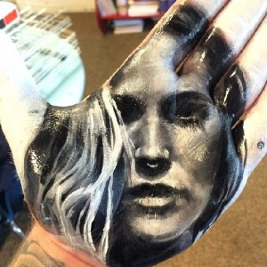 Painted on palm portrait of a beautiful woman. Artist Russell Powell
