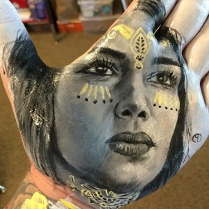Game of Thrones. Painted on palm portrait of Emilia Clarke. Art by Russell Powell