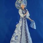Folk character of tales – Alyonushka. Gzhel doll