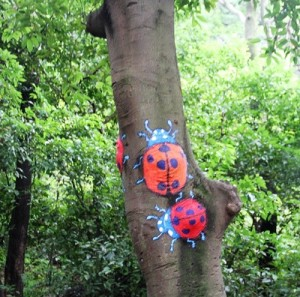 Two Ladybugs crawling the tree trunk. Creative street art by unknown artists in the city of Guilin