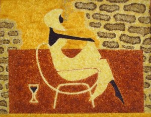 A girl with a wineglass. Painting of amber, Kaliningrad, Russia