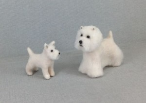 West Highland White Terrier with a pupp