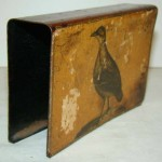 A bird painted on a matchbox holder