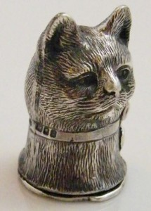 A cat. Matchbox holder figurine