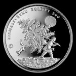 A man with a cut tree. Collectible coin issued by the Bank of Latvia