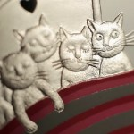 Closeup of Five cats in the bed, collectible coins