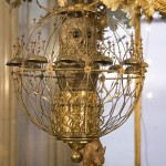 At the end of each hour, the clock mechanism starts owl, sitting in a cage