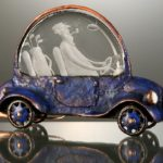 Going to golf. Engraved glass and metal sculpture by Dalibor Nesnidal