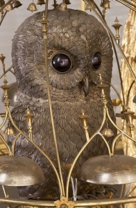 Owl in a gold cage