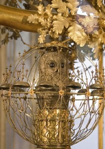 The golden tree of the Peacock clock is a home for other animals - squirrel and fox, for example