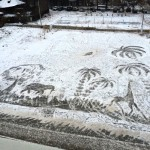 Hot African landscape with elephants, giraffes and palm trees on the cold snow. One-of-a-kind snow art by school janitor Semyon Bukharin, Izhevsk, Russia