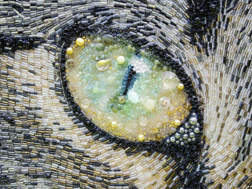Eye of a gray cat. Beads, glass beads, buttons, river pearl. Art work by British artist Sarah Jane Connors