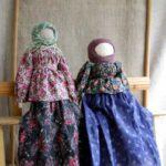 A couple of faceless folk dolls