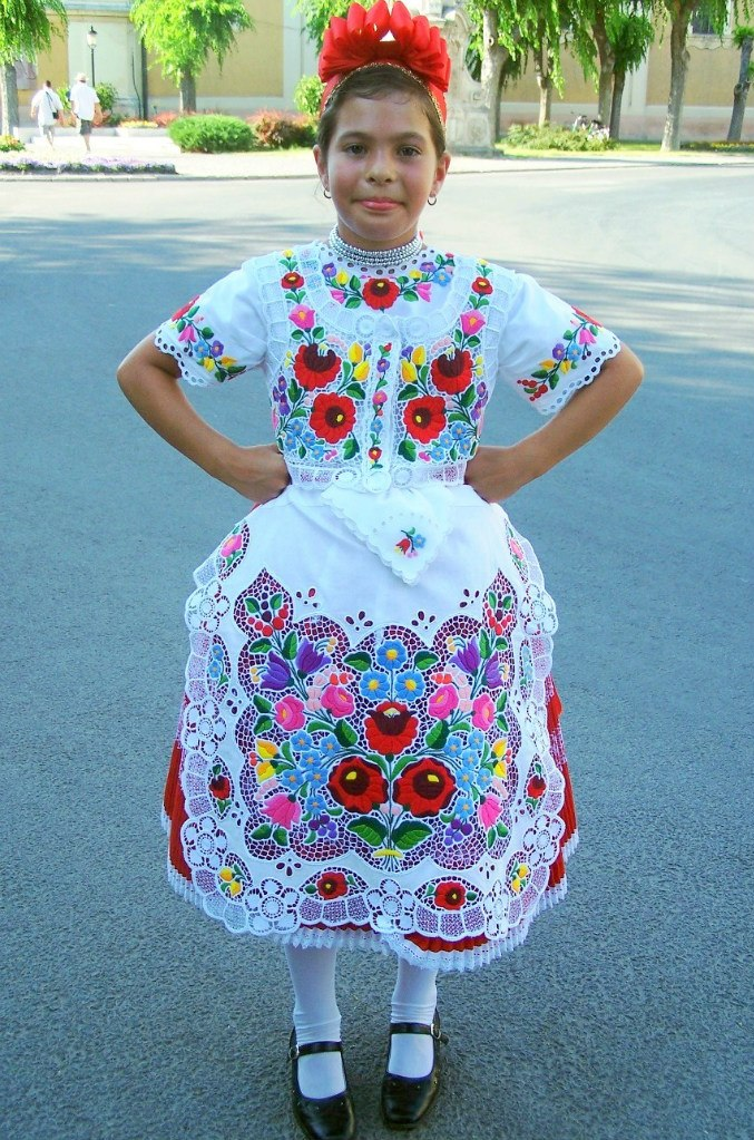 A girl in traditional Kalocsa embroidery
