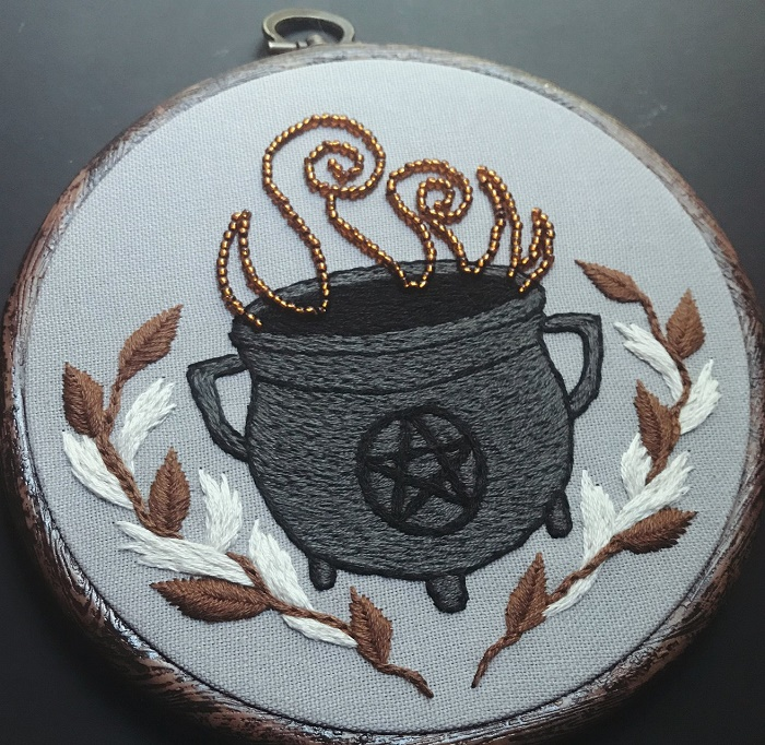 Magical Cauldron. Beaded smoke coming out of it. The cauldron represents the hearth, divinity, rebirth, regeneration, and wisdom, amongst other things