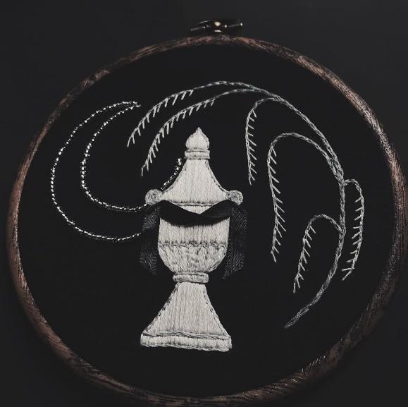 Sacred. moonlight white urn with black satin draping