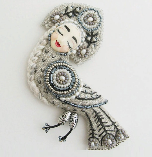 Alkonost Brooch from flax. Embroidered, freshwater pearls, beads, bugles. The face - polymer clay, painted with watercolors and watercolor pencils. Varnished in several layers