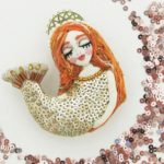 Mermaid brooch. Paillettes, beads and sequins. The face and hans of silk. Decorated with river pearls