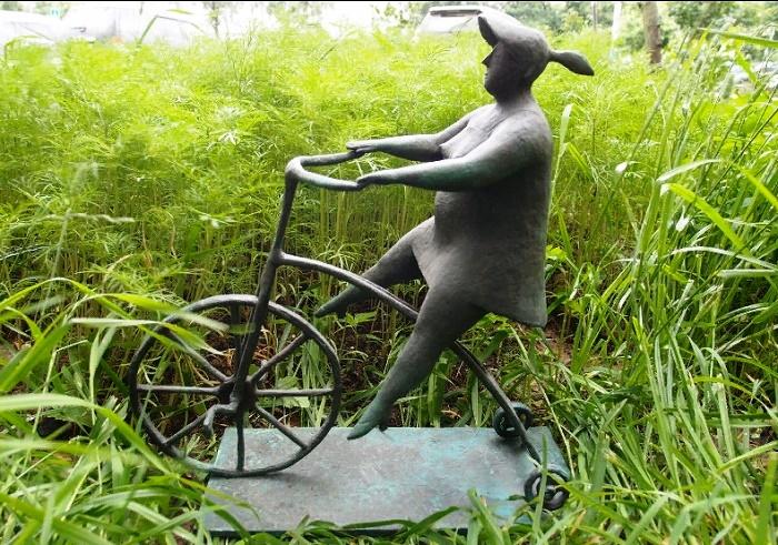 A cyclist. Bronze sculpture