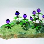 In the meadow. Amethyst jade vesuvian metal. Work by Ural stone cutter Viktor Vasiliev
