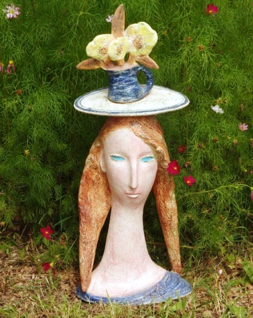 The sculptural portrait of a flower girl. Made of chamotte clay with the use of engobes and glazes. Dedicated to the artist Amadeo Modigliani. Romantic image of a blue-eyed girl with flowers on her head