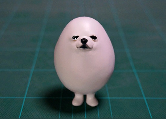 Cute white dog after haircut, sculpture