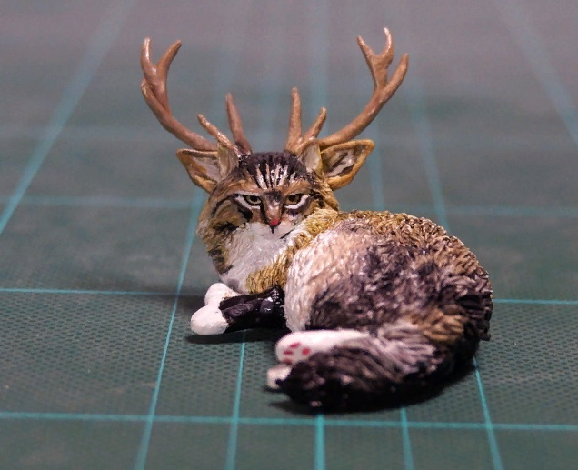 Horned cat sculpture