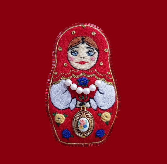 Matryoshka hand crafted brooch pin. 7.5 cm. Semi-woolen floss, felt, genuine leather, japanese toho beads, faux pearls, jewelry alloy, ceramics, metal accessories